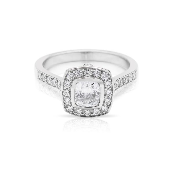Cushion cut diamond and platinum engagement ring