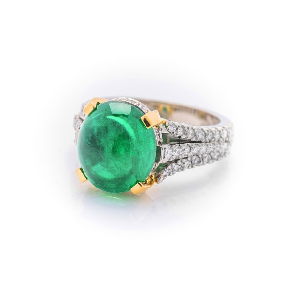 Hand made platinum and 18ct yellow gold diamond and cabachon colombian emerald dress ring
