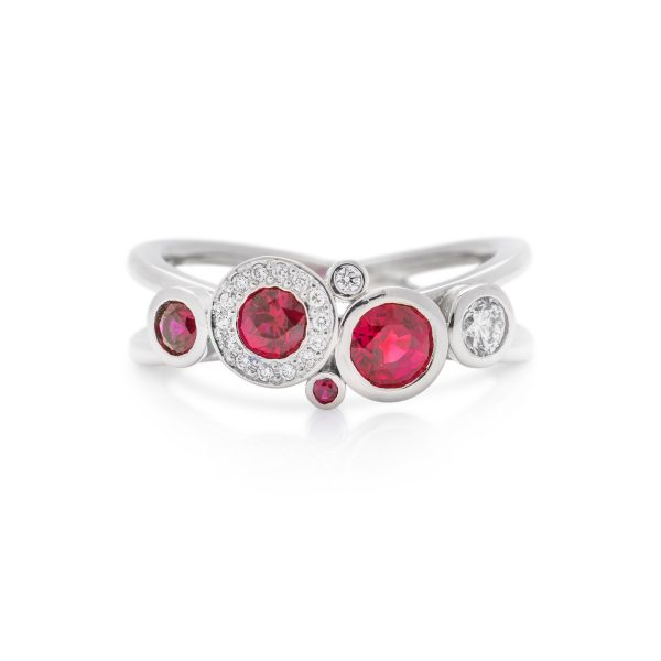 Platinum burmese ruby and diamond crossover dress ring, carbonated ring