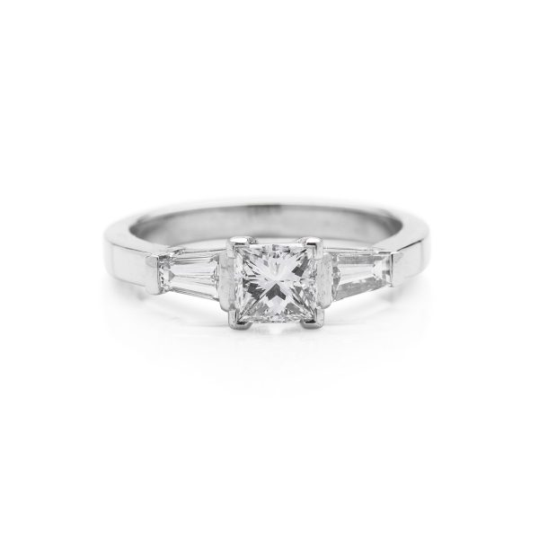 Princess cut diamond platinum 3 stone ring with tapered baguette side stones engagement ring