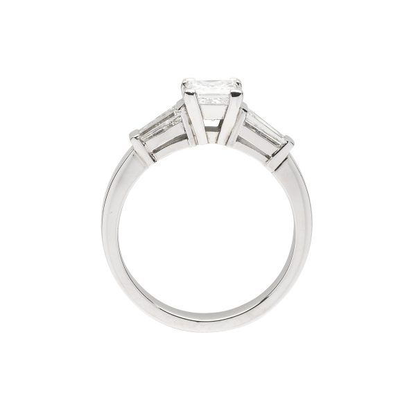 Princess cut diamond platinum 3 stone ring with tapered baguette side stones engagement ring - side view