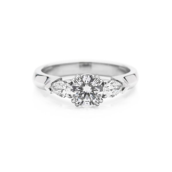 platinum 3 stone diamond engagement ring with pear shape side stones