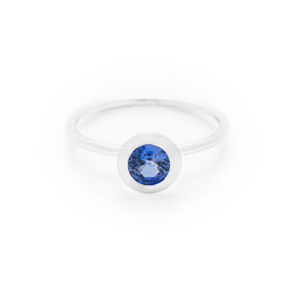 Blue sapphire dress ring made in 18ct white gold. From our flowers collection