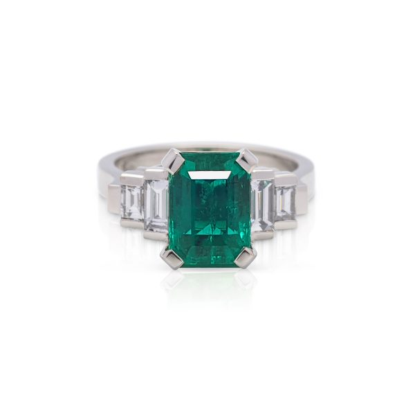 Hand made platinum diamond and colombian emerald cut dress ring
