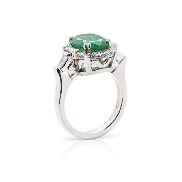 Hand made platinum diamond and oval colombian emerald dress ring - 3 quarter view