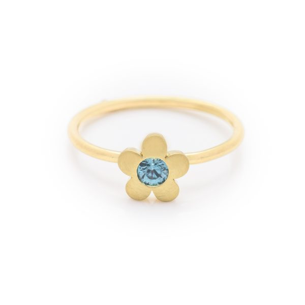 blue zircon dress ring made in 18ct yellow gold. From our flowers collection
