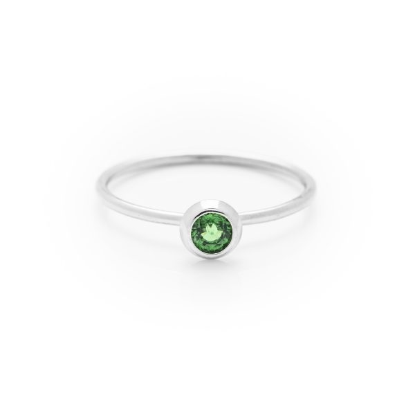 single tsavorite garnet dress ring made in 18ct white gold. From our flowers collection